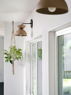 1970s Kitchen Remodel Before and Afters - Ceramic Sconces over the window- The Effortless Chic