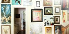 This gallery wall in a Nashville home features the works of Southern artists.