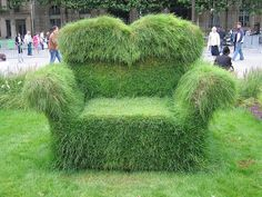 My girlfriend made a grass couch similar to this photo.  It was sooo cool and relatively easy to make!  Mowing was the only challenge keep that in mind when designing.
