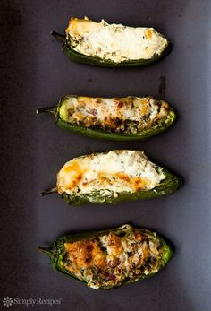 Baked Stuffed Jalapeños ~ Baked jalapeños stuffed with cheese, onions, cilantro and bacon, seasoned with oregano and cumin. ~ SimplyRecipes.com