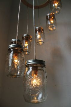 Spiral Carousel Mason Jar Chandelier - Mason Jar Lighting - Swag Lamp Handcrafted Upcycled BootsNGus Hanging Pendant Light Fixture. $200.00, via Etsy.