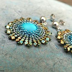 Disk shaped beaded earnings. Seed beads peyote and herringbone stitches