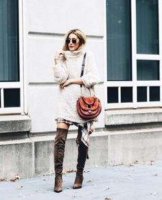 A chunky sweater, plaid skirt, and over-the-knee boots.