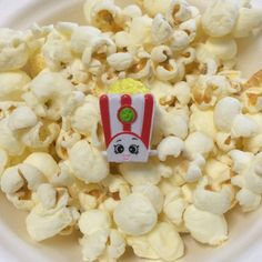 In honor of National Popcorn Lovers Day, hang with Poppy Corn and catch a movie! #PopcornLoversDay #PoppyCorn #SeasonTwo #shopkins