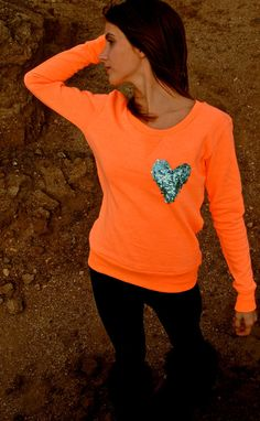 orange sweater with sequin heart.