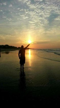He's got the whole sunrise, in his hands!  A fun moment in the sun at Emerald Isle by Evie Monk.
