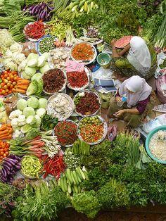 Woman selling food in Malasia
