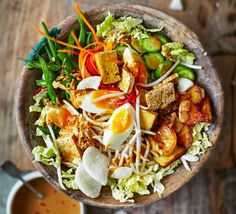 Aisha Nanor Martin's spicy Indonesian salad has it all; crunchy vegetables, boiled eggs, chilli peanut sauce, fresh coriander, fried tofu and a sprinkling of prawn crackers for added crunch