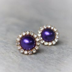 Purple pearl earrings with gold or silver setting!...
