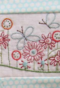 Embroidered flowers with butterflies, background idea for framed brooch projects