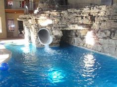Okay, that's totally me...An indoor pool is like my fantasy! And this one's got a cool slide:-)