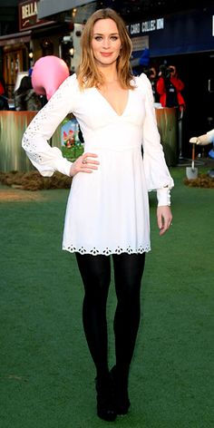 Emily Blunt wearing an eyelet Andrew Gn mini with black heels, Jamie Wolf aquamarine earrings and an Isharya ring.