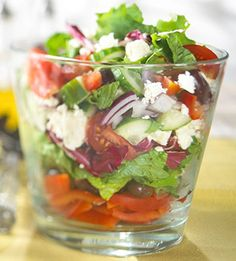 Of course we all know how to make a Greek salad, one of our favorite takeout items from the coffee shop, deli, or taverna in the neighborhood. Or do we? It sounds simple at first.