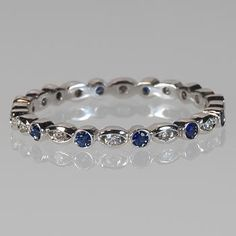 Thin Eternity Wedding Band with Blue Sapphire & Diamond Circle and Oval shapes White Gold Sapphire Jewelry, Sapphire Diamond, Blue Sapphire, Diamond Jewelry, Black Diamond, Eternity Ring Diamond, Eternity Bands, Solitaire Ring, Or Rose
