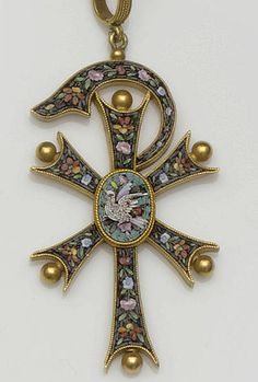 A late 19th century micro-mosaic cross pendant The Chi Rho cross motif decorated with inset micro-mosaic channels of floral and foliate sprays, to beaded terminals and ropetwist borders, centred with an oval panel depicting a dove amongst flowers, below a ropetwist decorated pendant bale, length 6.7cm.