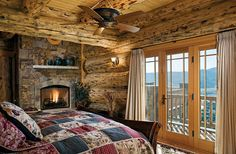 A Log Home Getaway on the Rockies Wooden Sleigh Bed, Rustic Bunk Beds, Corner Stone Fireplace, Wooden Dining Set, Rustic Master Bedroom, Wood Columns, Large Beds, Bed Lights, Bedroom Photos