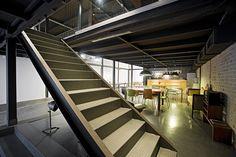 Sleek metallic staircase leading to the top level