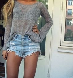 Light grey jumper with some light blue shorts