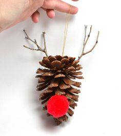DIY Pine Cone Ornament - 20 Pine Cone Decorating Ideas For The Holidays | Christmas And Thanksgiving Crafts & Projects by Pioneer Settler at http://pioneersettler.com/pine-cone-decorating-ideas/