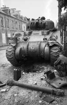 A knocked out Sherman in Villers-Bocage. *Note the main gun was blown completely off.