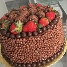 This ultimate chocolate cake topped with strawberries and chocolate truffleshellip