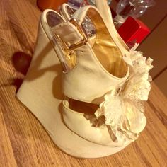 Cream suede wedge with flower Cream suede wedges with flower in center. Worn a few times, some wear is shown etc. a few gray spots, other than that still in good condition. So cute! Qupid Shoes Wedges