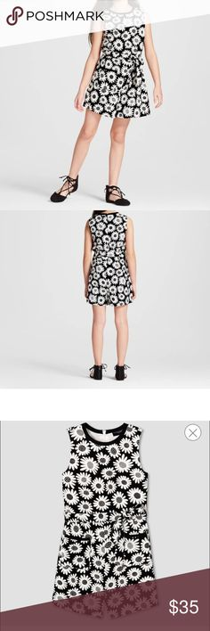 Black Daisy Tie Waist Romper - Victoria Beckham Your stylish little lady will rock an on-trend look with this Girls' Black Mini Daisy Tie Waist Romper by Victoria Beckham for Target. Cute and comfy, this fun 1-piece design gives her an instant outfit. The Victoria Beckham collection for Target celebrates the shared experiences between Victoria and her daughter. The result is a look that's fashionable, yet free-spirited and timeless. Sz M & L Victoria Beckham for Target One Pieces