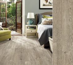 Shaw laminate in a rustic visual with lots of texture including chatter marks. Style Avenues, color Limed Oak.