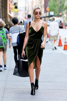 On Hailey Baldwin: Vatanika Velvet Dress; Dior boots.
