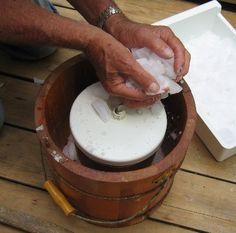 filling ice cream freezer with ice