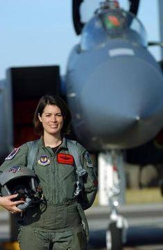 Cool! = Maj. Nicole Malachowski (now Lt Colonel) first female pilot in USAF Thunderbirds.