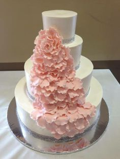 Wedding Cake of the Weekend! An elegant cake with fondant flower petals made by Some Crust Bakery.