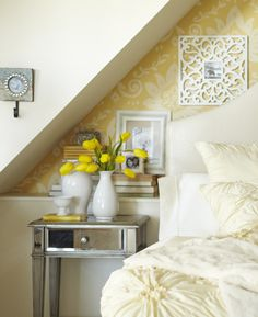 Have fun by hanging intricate frames against patterned wallpaper