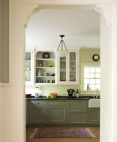 White upper cabinets with wood lowers white subway tile for Galley kitchen without upper cabinets