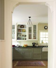 Modern craftsman kitchen.  dark lower cabinets with light floor, dark counters and white upper