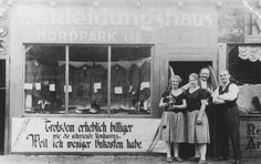 Kajla and Jakob Uszerowicz and another couple stand outside their clothing store in Berlin. 1928