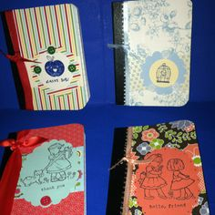 Altered mini composition notebooks/ maybe for address books for delegates.