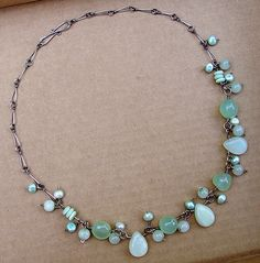 aqua agate1 by lunedesigns  Aqua agate, new jade, freshwater pearl, opalescent matte glass discs, handforged antiqued sterling chain and S-clasp.
