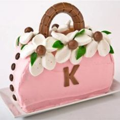 Sweet! How to make a purse birthday cake with Tootsie Rolls. Easy, step-by-step recipe, diagrams and pictures