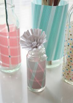 Washi Tape on Glass Bottles. Could also do this with mason jars as centerpieces!