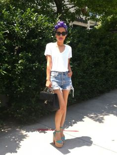 Hermes scarves as turban, Levis vintage shorts, Christian Louboutin's Super Dombasle, Vince tees, and Chanel bag.