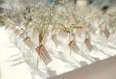 Just a sprig of baby's breath or an herb makes a dainty, pretty table card display.   Then you could have a larger jar of same as centerpiece!