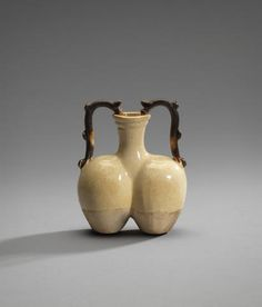 An unusual straw-glazed miniature double amphora vase Sui Dynasty