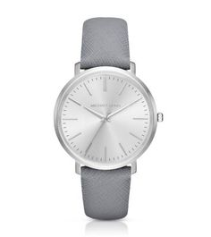 Exclusively Ours in Michael Kors stores and on michaelkors.com until 7/30/16. Exceptionally sleek and streamlined, this polished timepiece features a slim silhouette that gives it a minimalist look and feel. With a luxe leather strap and silver-tone stainless steel case, our new Jaryn watch offers a fresh take on an essential accessory. Elevate this classic style by pairing it with delicate tonal bracelets.