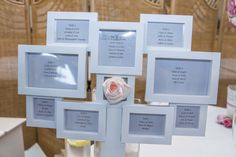 Simple, framed seating plan with colour matching rose.