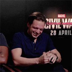 Sebastian Stan laughing on Captain America: Civil War Press Tour