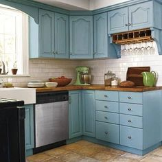 Achieve the best blue kitchen with Olympic's paint color Kingston Aqua on your kitchen cabinets
