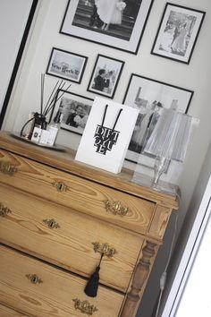 Homevialaura | wooden antique dresser | tassel | diptyque | gallery wall | Kartell Take lamp | room scent