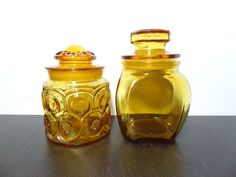 Vintage Amber Yellow Glass Canister/Apothecary Jars - Set of 2 - L.E. Smith Moon & Stars Canister and a Smooth 4 Sided Canister by DaysLongGoneSalvage on Etsy