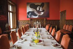 "In the dining room, ""Gray Mouse,"" 1995, looms over the table set for lunch. / Get started on liberating your interior design at Decoraid (decoraid.com)"